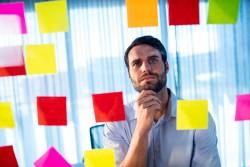 Man focusing on notes